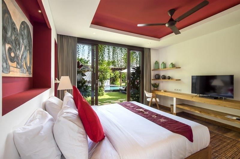Villa Anam Bedroom with TV and Pool View, Seminyak | 7 Bedroom Villas Bali
